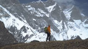 Man with backpack climb the mountain slope in the Himalayas stock footage