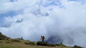 Man with backpack climb the mountain slope in the Himalayas stock video