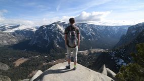 Man with backpack enjoy mountain in Yosemite National Park.  stock video