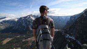 Man with backpack enjoy mountain in Yosemite National Park.  stock footage