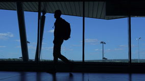 A man with a backpack goes on the airport terminal. stock footage