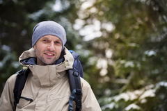 The man with the backpack. Man with a backpack goes through the dark forest Stock Photos