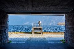 Man with a backpack goes to the pier. Mountain lake Traunsee  in Austria, Salzkammergut region.  stock images