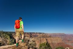 Man with backpack in Grand Canyon National Park Stock Photo