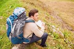 Man with backpack hiking Royalty Free Stock Photography