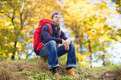 Man with backpack hiking Stock Photography