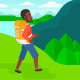 Man with backpack hiking. Royalty Free Stock Image