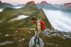 Man with backpack hiking alone in mountains royalty free stock photos