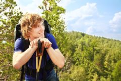 Man with backpack hiking in the mountains Royalty Free Stock Image