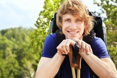 Man with backpack hiking in the mountains Stock Image