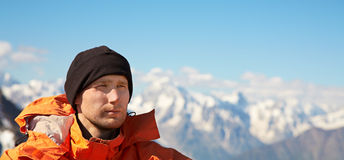 Man with backpack hiking in the mountains Stock Photos