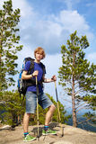 Man with backpack hiking in the mountains Stock Photo