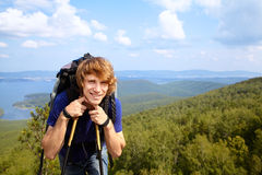 Man with backpack hiking in the mountains Stock Images