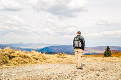 Man With Backpack Hiking in Spring Stock Photos