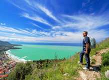 Man with backpack looking at Cefalu, Sicily Royalty Free Stock Photo