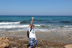 A man with a backpack on the Mediterranean Sea, Cyprus, Protaras Royalty Free Stock Images