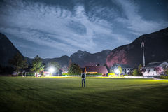 Man With Backpack on Middle of Grass Field during Night Stock Image
