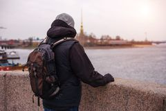 A man with a backpack is on the Neva river in St. Petersburg.  Royalty Free Stock Photography
