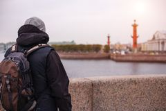 A man with a backpack is on the Neva river in St. Petersburg.  Royalty Free Stock Images