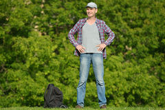 Man with backpack in a park Stock Photo