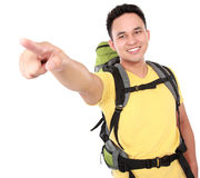 Man with backpack pointing to the direction with hand Stock Images