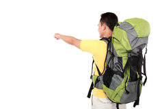 Man with backpack pointing to the direction with hand Stock Photos