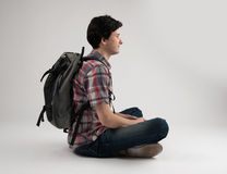 Man with backpack sitting Royalty Free Stock Photos