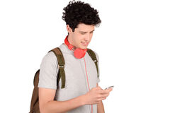 Man with backpack and smartphone. Royalty Free Stock Photography
