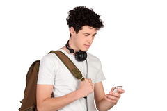 Man with backpack and smartphone. Stock Image