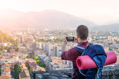 Man with backpack taking a picture. Of landscape Royalty Free Stock Photo