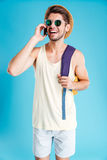 Man with backpack talking on cell phone Stock Photos