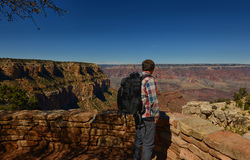 A man with a backpack visiting the Grand Canyon Stock Photos