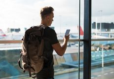 Man with backpack walking in airport Stock Image