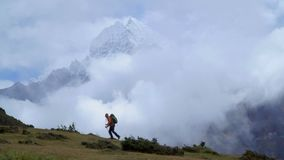 Man with backpack climb the mountain slope in the Himalayas. Man with backpack are walking along the mountain slope in the Himalayas. A view of the beautiful stock video
