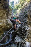 Man backpacker going down in a gorge Stock Images