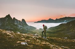 Man backpacker hiking in mountains alone outdoor. Active lifestyle travel adventure vacations sunset Norway landscape royalty free stock photography