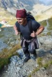 Man backpacker hiking on a trail Royalty Free Stock Photography
