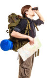 Man backpacker with map looking through binoculars Stock Image