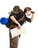 Man backpacker with map looking through binoculars Royalty Free Stock Image