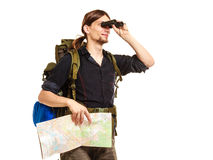 Man backpacker with map looking through binoculars Stock Image