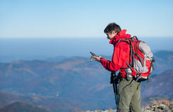 Man backpacker on the peak of the mountain Stock Photos