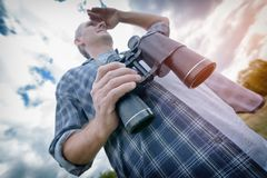 Man on the trail holding binoculars Royalty Free Stock Photos