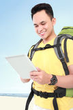 Man backpacker using tablet pc Stock Photography