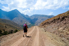 Man backpacking in atlas mountains, morocco. Man hiking along track in atlas mountains, morocco stock photos