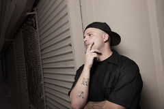 Man with a backwards hat Royalty Free Stock Image
