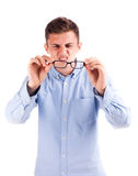 Man with bad vision hold glasses Stock Photo