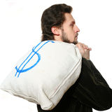 Man with bag on his back Stock Image
