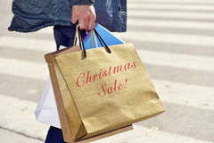 Man with a bag with the text christmas sale Stock Photography