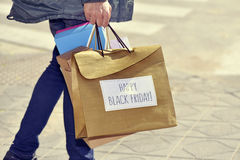 Man with a bag with the text happy black friday Royalty Free Stock Photo