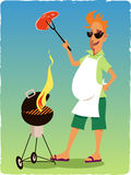 Man bagbecuing steak on a grill Royalty Free Stock Images